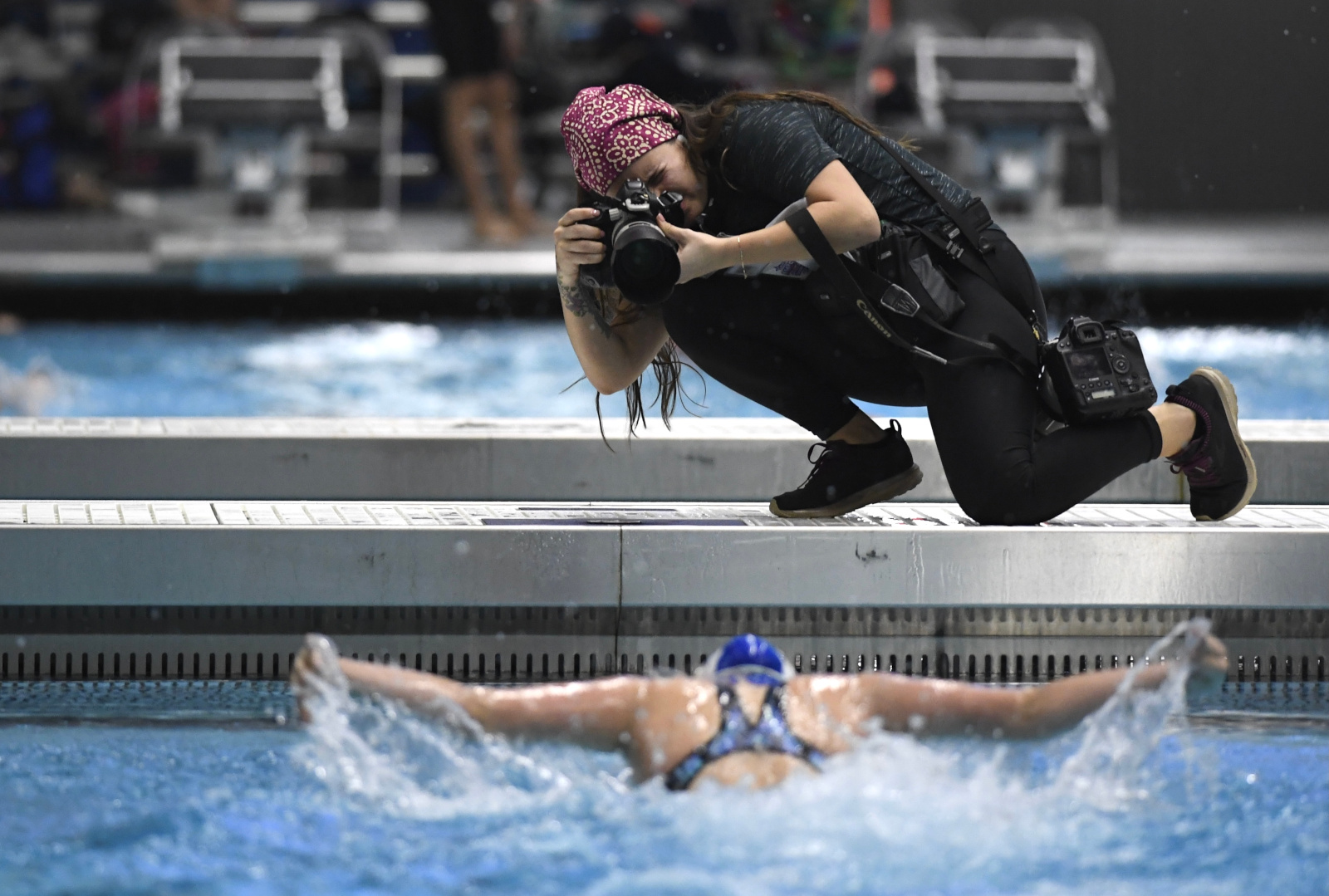 Photographer at swim meet